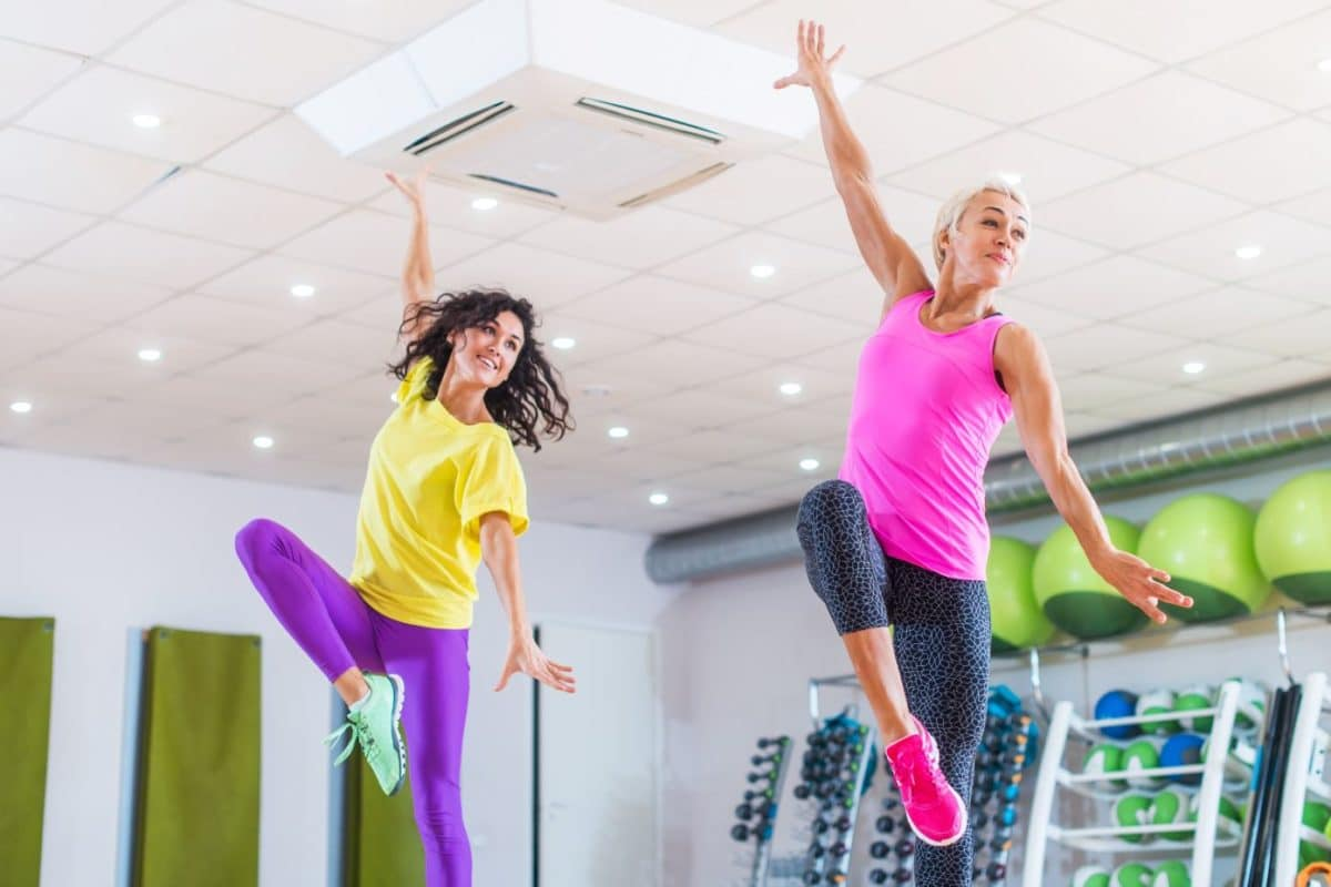 Two women exercising in a dance fitness studio
