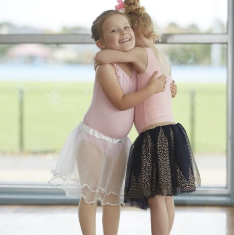 Children hugging in a Kinderballet Class